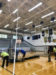 Accurate Striping Staff installing donated flag